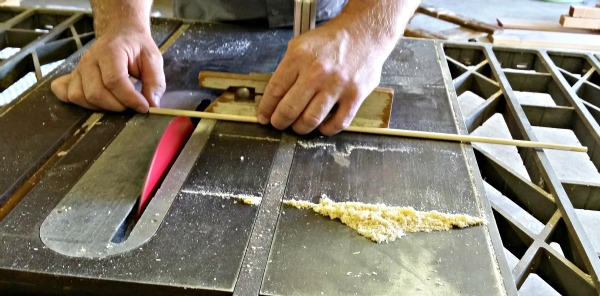 "Cutting a dowel into 2"" pieces"